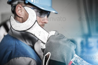Worker with Huge Wrench