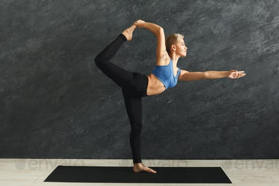 Woman training yoga in std bow pose
