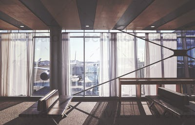 Retro stylized picture of empty seats in an airport departure ha