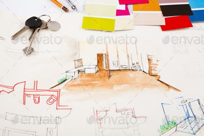 Designers tools on hand painted sketch of room