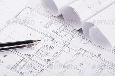Architectural project, engineering tools on table.