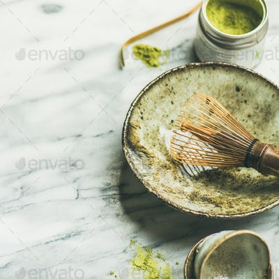 Japanese tools for brewing matcha tea, marble background, square crop