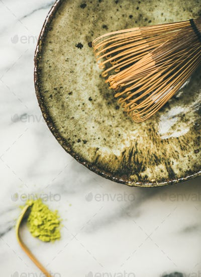 Japanese tools and bowls for brewing matcha tea, marble background