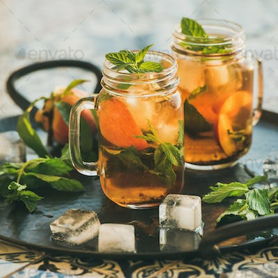 Summer refreshing cold peach ice tea, copy space