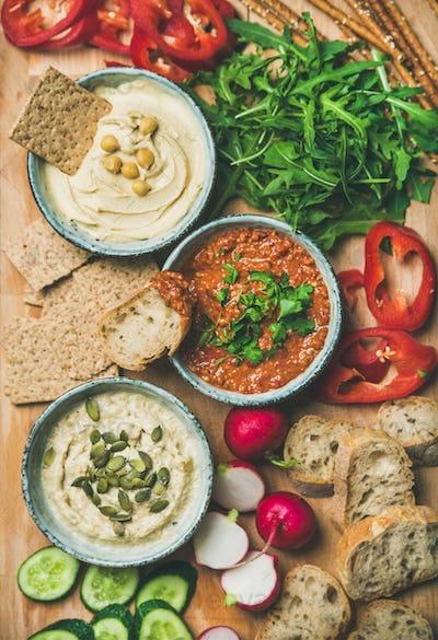 Vegan snack board. Flat-lay of Vegetarian dips hummus, babaganush, muhammara