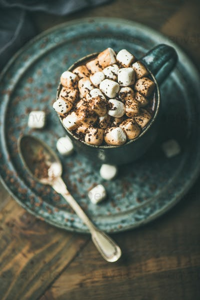 Winter warming sweet drink hot chocolate with marshmallows in mug