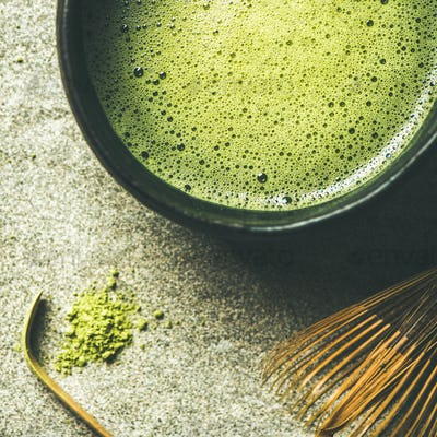 Flat-lay of freshly brewed Japanese matcha green tea, square crop