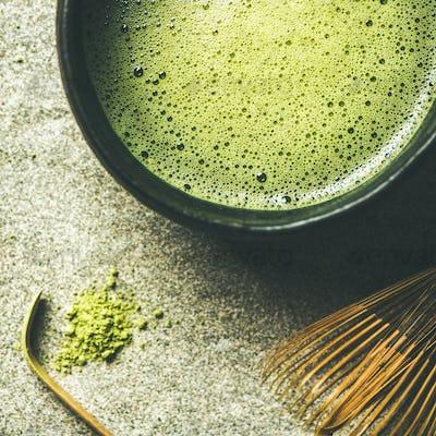 Flat-lay of freshly brewed Japanese matcha green tea, square crop