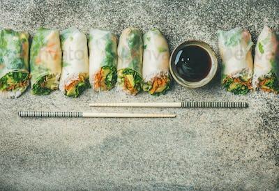 Flat-lay of vegan spring or summer rice paper rolls
