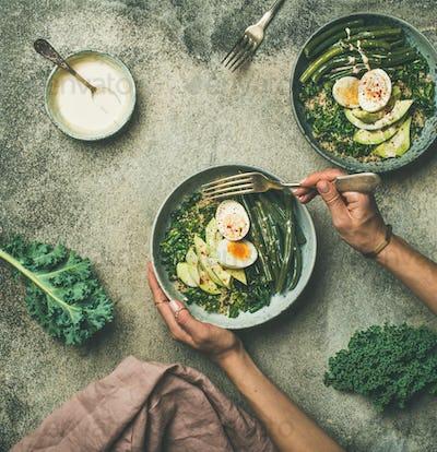 Quinoa, kale, beans, avocado, egg bowls flat-lay, top view