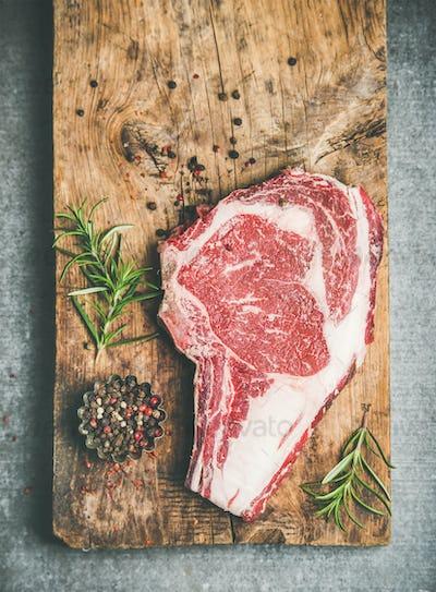 Flat-lay of raw prime beef meat dry-aged steak rib-eye