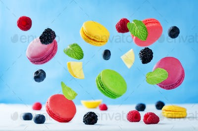 Multicolored flying macaroni with berries and mint