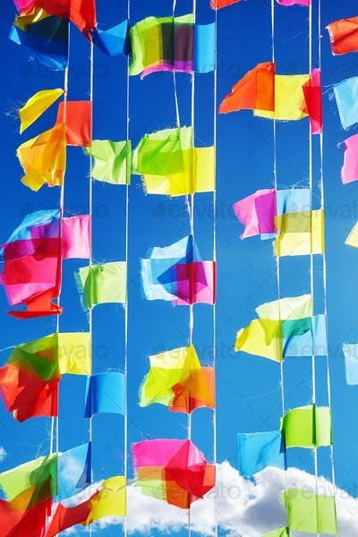 Colorful prayer flags against the blue sky