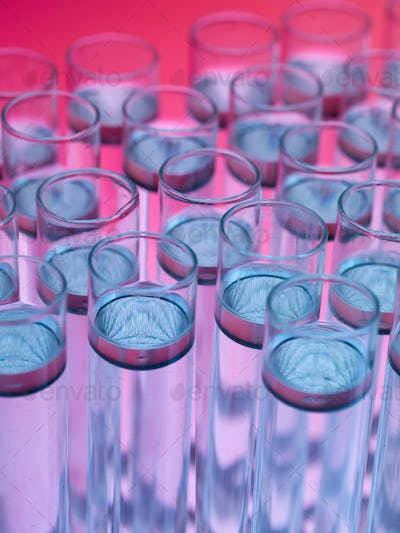 laboratory test tubes filled with liquid substances