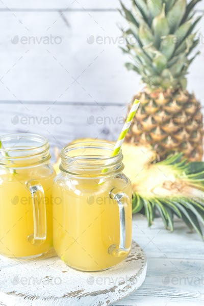 Two glasses of pineapple juice