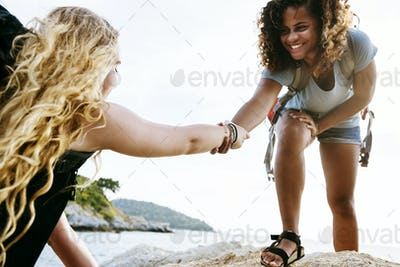Young women helping each other