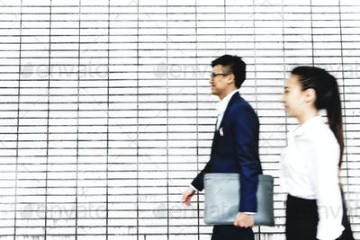 Asian business people walking