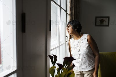 Senior woman looking at the window