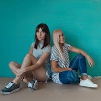 Two hipster girls posing in studio