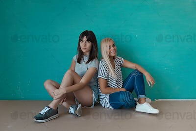 Two hipster girls posing in studio