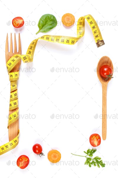 Frame of fork with centimeter and vegetables