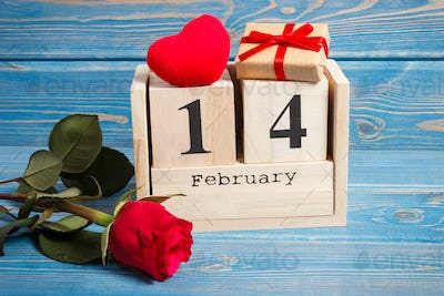 Date of 14 February on calendar, gift, red heart and rose flower, Valentines day concept