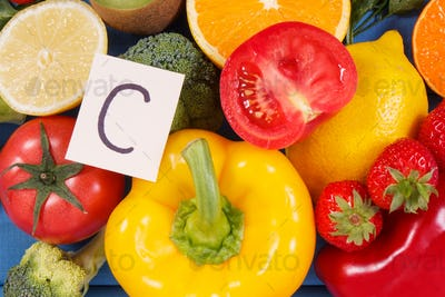 Fruits and vegetables containing vitamin C and natural minerals, healthy nutrition concept