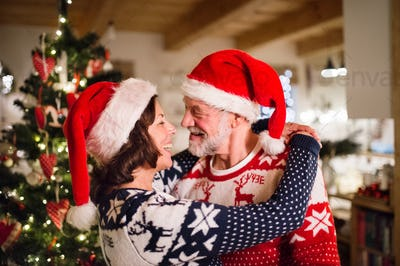 Senior couple with Santa hats at Christmas time.