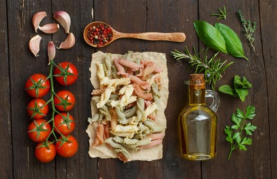 Tricolor pasta, vegetables, herbs and olive oil