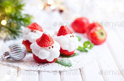 Christmas strawberry Santa. Funny dessert stuffed with whipped c