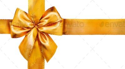 Gold satin gift bow. Ribbon isolated on white background