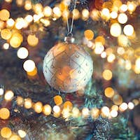 Decorated Christmas tree. Abstract blurred bokeh holiday backgro