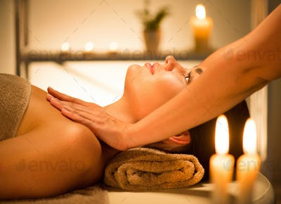 Spa. Beauty brunette woman enjoying relaxing body massage in spa