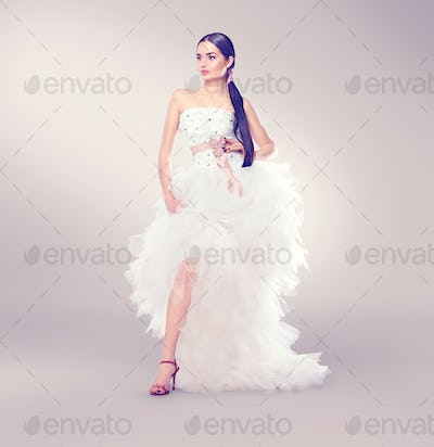 Beauty fashion young model bride in wedding dress with long trai