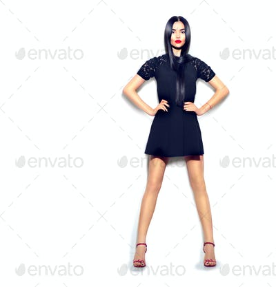 Fashion model girl wearing little black dress isolated over whit
