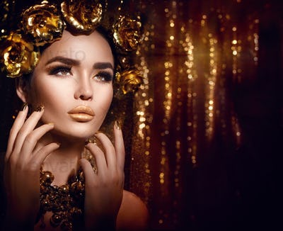 Golden holiday makeup. Golden wreath and necklace. Fashion art h