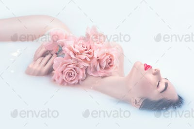 Beautiful fashion model girl with bright makeup and pink roses t