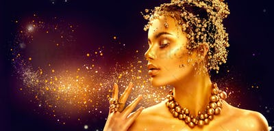 Gold woman skin. Beauty fashion model girl with golden makeup, h
