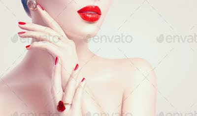 Sexy woman. Red lips and nails closeup. Manicure and makeup. Ski