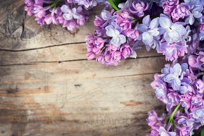 Lilac flowers bunch over wood background