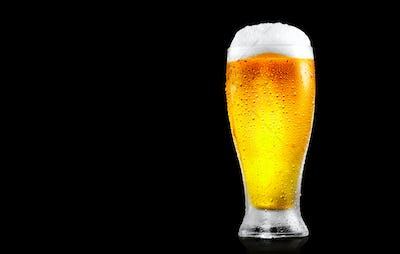 Beer. Glass of cold beer with water drops. Craft beer isolated o