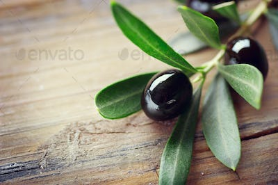Olive over wood background. Fresh and healthy organic olives bor