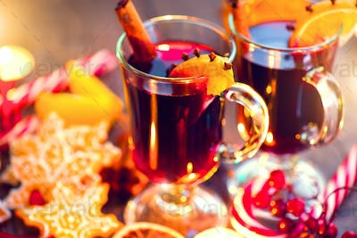 Christmas traditional mulled wine on holiday decorated table