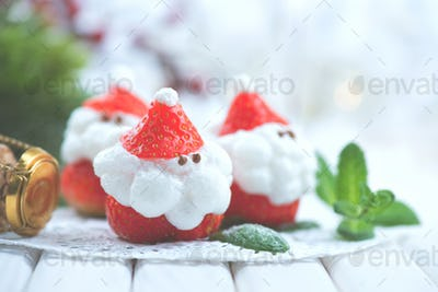 Christmas holiday dessert. Strawberry Santa stuffed with whipped