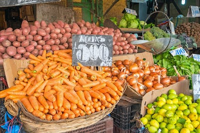 Vegetables and salad in baskets at a market
