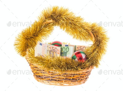 Christmas wicker basket full of euro bills.