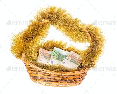 Wicker basket full of euro bills.