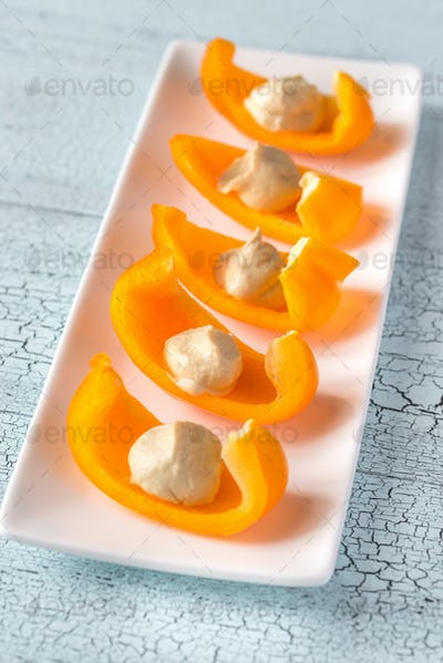 Slices of bell pepper with hummus