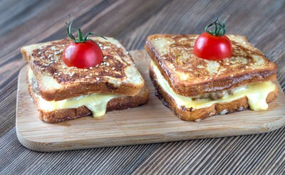 Cheeseburger french toasts on the wooden board