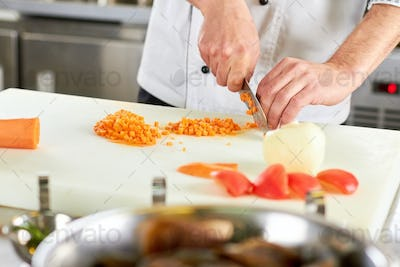 Chef dicing carrot.